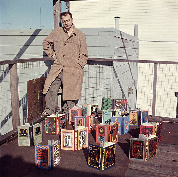 2 Kenneth-Patchen-in-1957-with-a-collection-of-his-painted-books.-The-photograph-was-taken-by-the-late-photographer-Harry-Redl-on-the-rooftop-of-his-apartment-house-in-San-Francisco.jpg