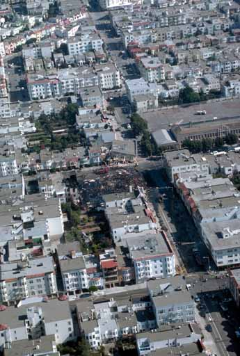 Aerial view of collapsed buildings and burned-out section at Beach and Divisadero Streets, Marina District; C.E. Meyer, U.S. Geological Survey