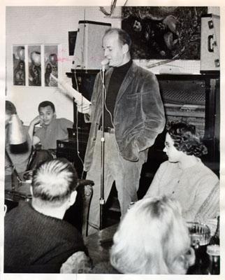 Lawrence Ferlinghetti reading poetry at The Coffee Gallery on Grant Avenue Dec 28 1959 AAD-2816.jpg