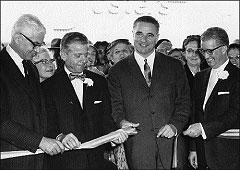 George-Christopher-cuts-the-ribbon-at-Stonestown.jpg