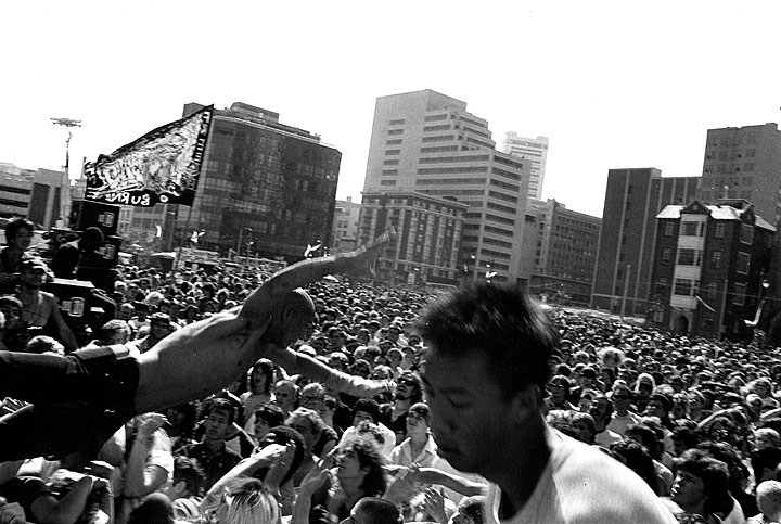 July-1984-stage-diver-at-rock-against-racism-concert-in-front-of-Democratic-Convention.jpg