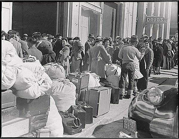 Japanese-waiting-On-Van-Ness-to-be-transported-to-camps-1942-by-Dorothea-Lange-via-FB.jpg