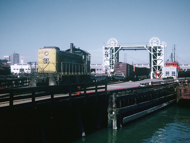 File:Switching-at-China-Basin-slip-in-San-Francisco,-CA.-Santa-Fe-tugs-John-R.-Hayden-(left)-and-Paul-P.-Hastings-stand-by-near-barges-6-and-8.-Western-Railway-Museum-Archives.-Jeff-Moreau-collection.-Circa-March-1971 88505atsf.jpg
