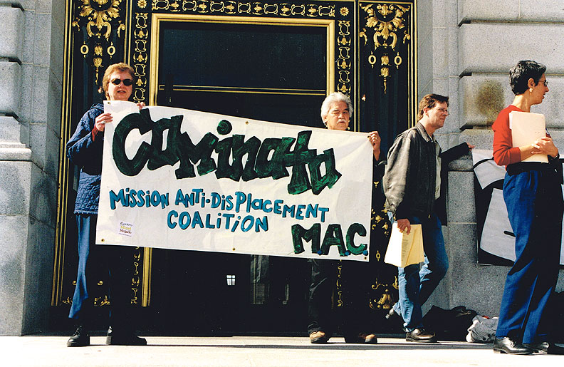 Bill-Sorro-and-Betty-Traynor-on-City-Hall-steps-during-1999-Grant-Bldg-protest-with-MAC-sign.jpg