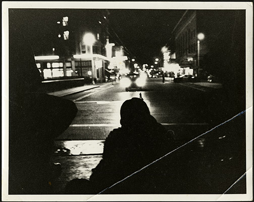 Officer aiming a gun at night during the 1966 Bayview-Hunters Point riots AAK-1657.jpg