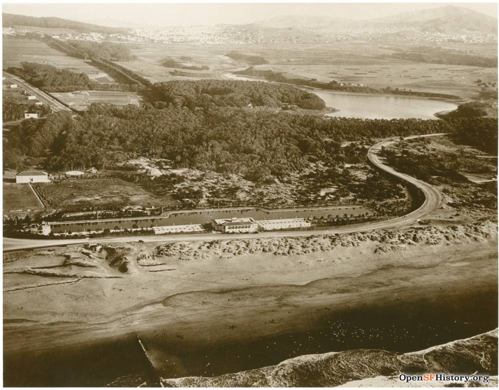 Fleishhacker Pool c 1930 Aerial view of Fleishhacker pool and playground looking southeast. Mothers Building at far left. Breakers on Ocean Beach in foreground. Lake Merced upper right. wnp70.0495.jpg