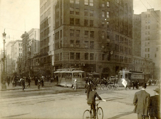 Market and kearny 1909 w bicyclist AAB-6218.jpg