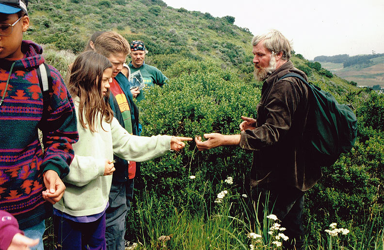 David-schooley-and-kids-on-SB-Mtn-looking-at-flowers-1994.jpg