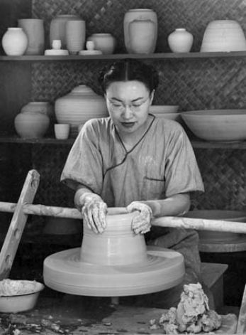 Jade Snow Wong at the ceramics wheel