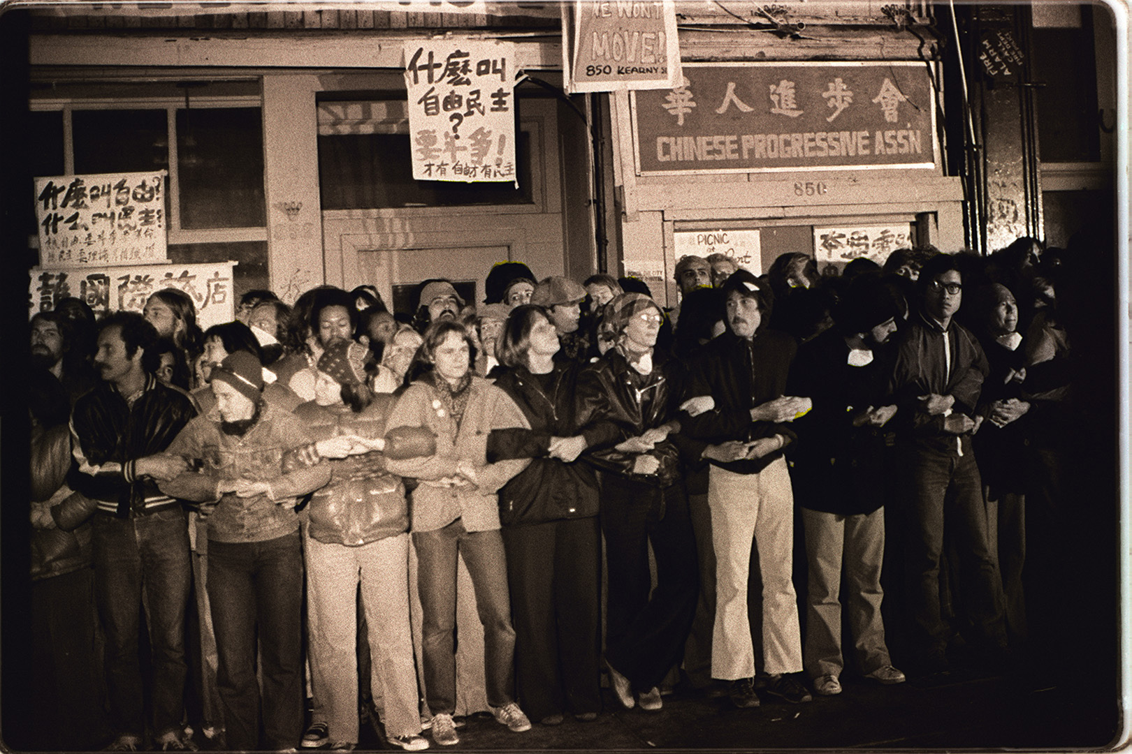 Protesters lock arms to prevent the eviction of the International Hotel tenants, 1977 Nancy Wong.jpg