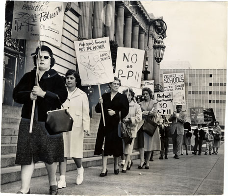 Image:Picketers protesting against the Southern Freeway marching at City Hall April 18 1961 AAF-0671.jpg