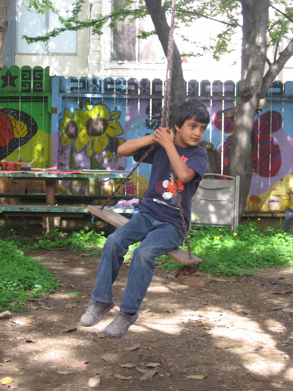 Young boy on swing in Jardín Secreto IMG 9299.JPG