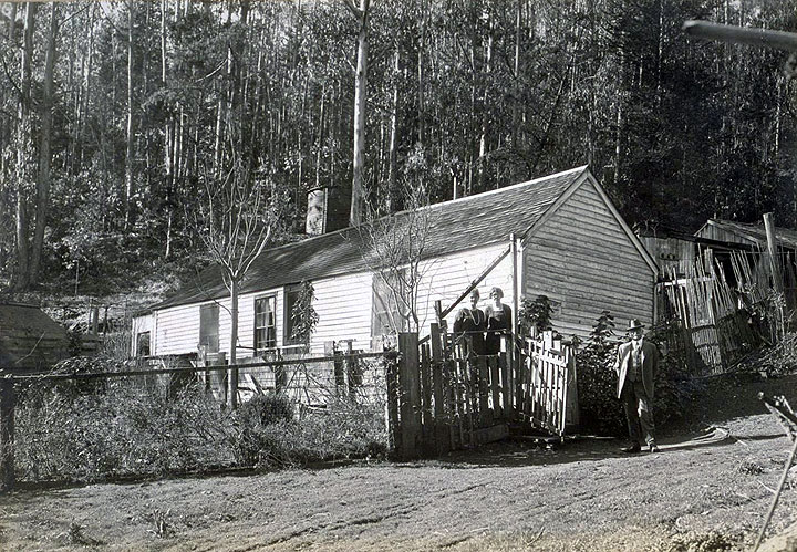 The-Old-home-in-the-Heart-of-the-Sutro-Forest,-back-of-Twin-Peaks,-built-about-1860.-Photo-taken-Jany-1925.-Jesse-B.-Cook-at-the-gate.jpg