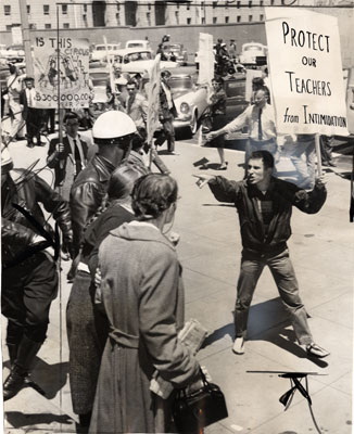 Anti-HUAC demonstrator points at police May 1960 AAK-0830.jpg