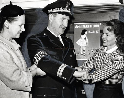 Mrs. Haurat, area chairman, and Mrs. Valdespino, chairman of the Mother's March on Polio with Deputy Police Chief Thomas Cahill jan 28 1957 AAK-1326.jpg