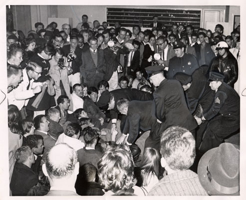 Police picking out demonstrators from the lobby of the Sheraton Palace Hotel March 7 1964 AAK-0899.jpg