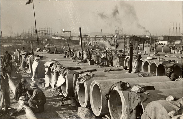 Water pipes used as shelter by jobless people 1932 AAK-0435.jpg