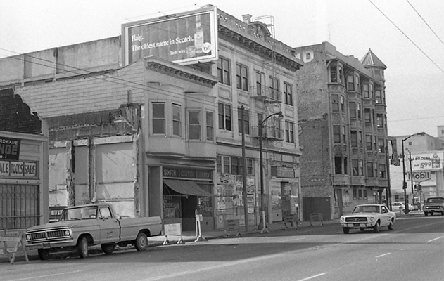 Buildings on the 700 block of Howard before being demolished as part of South of Market Redevelopment, South Center Library and Jim's General Merchandise as seen from across the street Oct 1970 TOR-0007.jpg