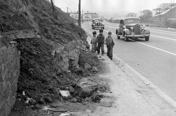 Bernal cut hazardous roadway w 3 kids 1942 AAA-9927.jpg