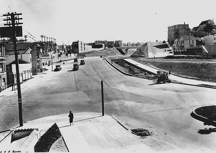 San-Jose-Ave-sw-at-Dolores-and-Randall-w-Mission-back-left--Highland-overpass-in-center-distance-This-was-Opening-Day-for-new-Bernal-cut-April-16-1930-SFDPW.jpg