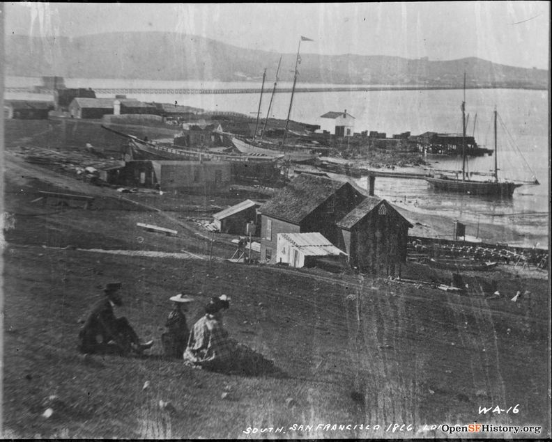 South San Francisco 1866 Long Bridge WA-16 View north towards Long Bridge from Hunters Point towards Point San Quentin-Mission Bay Houses, berthed boats; man, woman and child sitting F810 WA-016 GGNRA-Behrman GOGA 35346 wnp71.2239.jpg