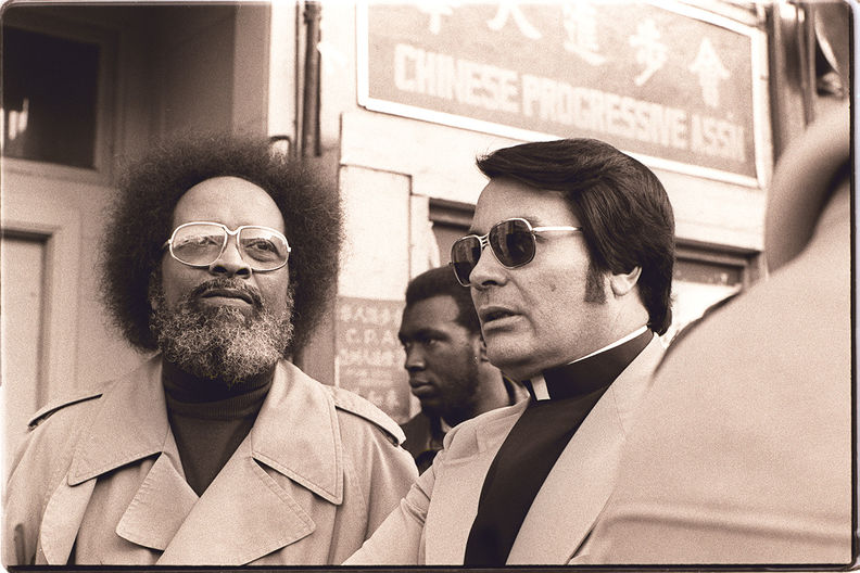 Cecil Williams and Jim Jones at anti-eviction rally at the I-Hotel, January 1977 Nancy Wong.jpg