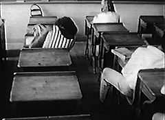 Kids asleep in largely deserted Mission High classroom, 1969