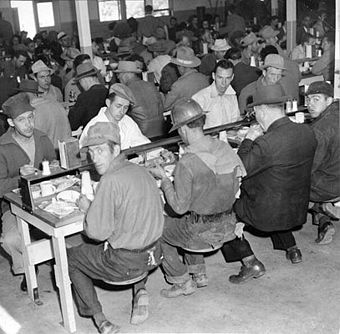 Workers dining in a cafeteria at Hunters Point Drydock; notably not an integrated cafeteria at in this 1943 photo, courtesy San Francisco History Center, San Francisco Public Library
