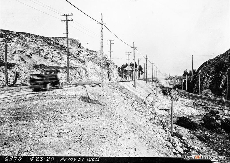 Army Street Wall, View east on Army Street (now Cesar Chavez) near present day Evans. Ocean Shore Railway tracks at right, footbridge at Connecticut Street in distance--wnp36.02268.jpg