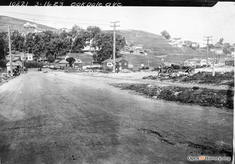 March 16 1926 View West on Oakdale near Toland. Old Clam House at the intersection of Bayshore (then San Bruno Avenue). Bernal Heights and site of US101 freeway in background. Oakdale Ave to Bernal dpwbook36 dpw10221 wnp36.03371.jpg