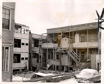 Dilapidated apartment buildings in the Western Addition 1953 AAC-1913.jpg