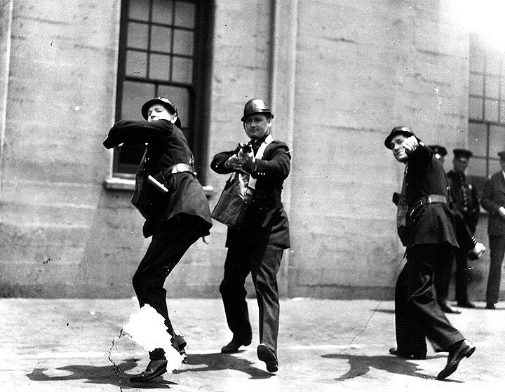 Staged-publicity-shot-of-SF-police-practicing-with-tear-gas ILWU-archives.jpg