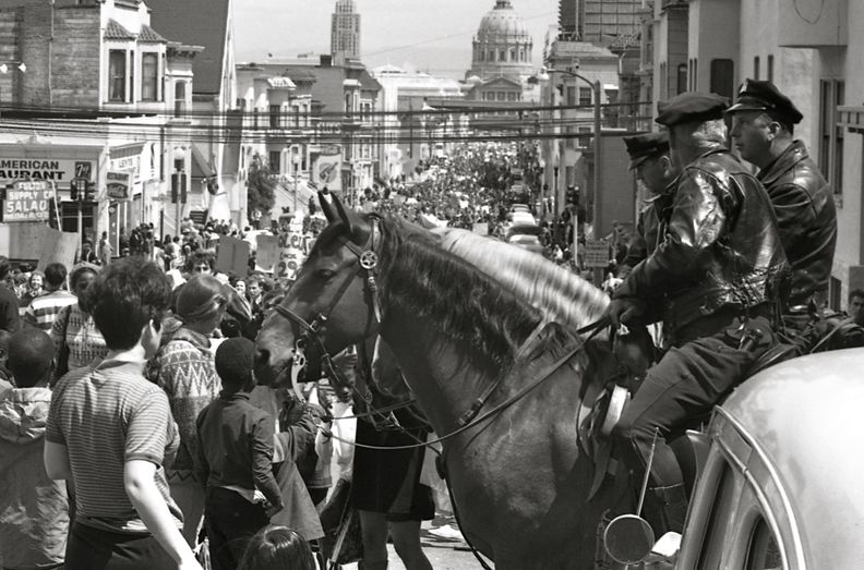 Mounted policemen watch a Vietnam War protest march in San Francisco, April 1967.jpg