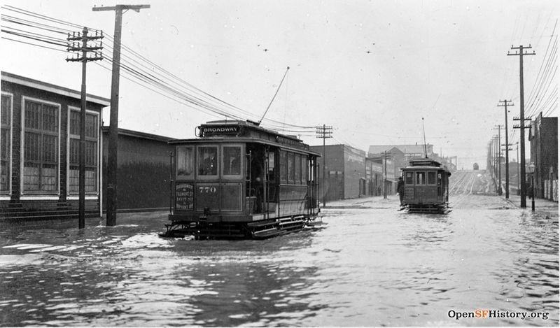 1905 16th St, at Folsom, looking east. Streetcars driving through flood, car 770 wnp32.0263.jpg