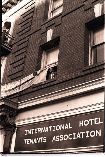 Joe Diones looks out the window of the I-Hotel on 848 Kearny Street Nancy Wong.jpg