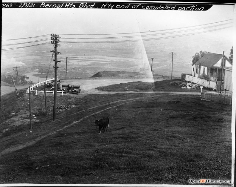 Feb 9 1931 Cow - Automobiles Bernal Hts. Blvd., north end of completed portion dpwbookSPECIMP16 dpwA2869 View east towards Islais Creek marshland reclamation, 31 Carver St. across road at right wnp36.04318.jpg