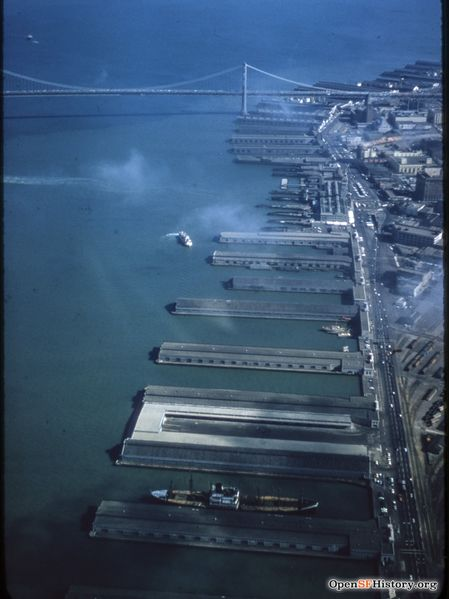 File:C1955 Aerial view looking south toward Bay Bridge, Belt Line Railroad yard at lower right. Ferry Building with vehicle underpass in front wnp25.2056.jpg
