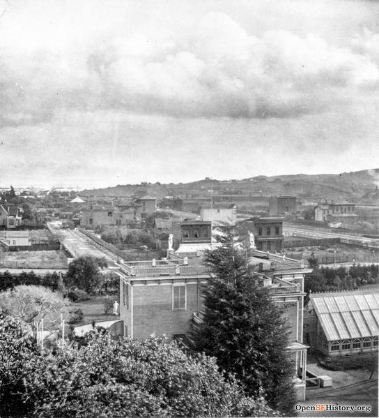File:East view from Woodwards c 1869 Woodward's Gardens, elevated view east across Mission District to Potrero Hill showing rear of museum and conservatory. Erie Street on other side of Mission wnp26.639.jpg