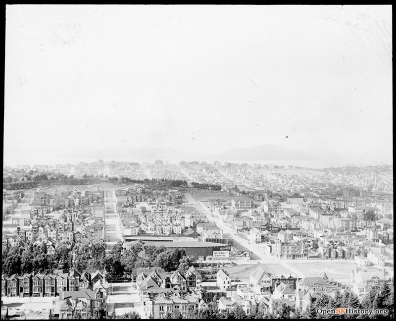 C1902 Golden Gate Park Panhandle and The Velodrome in foreground, on the site of the Southern Pacific Hospital at Baker and Fell. In the background is Calvary Cemetery. Part of a Panorama From Buena Vista Park wnp13.032.jpg