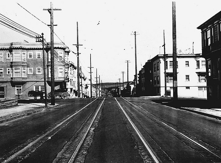 8th-Ave-north-at-Cabrillo-Beer-Drummer-at-left-Presidio-in-distance-1927-SFPL.jpg