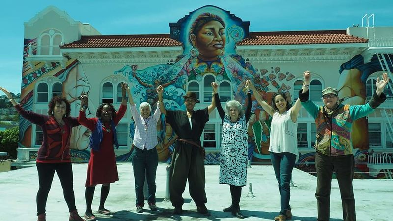 File:Womens Building artists on roof in front of mural.jpg